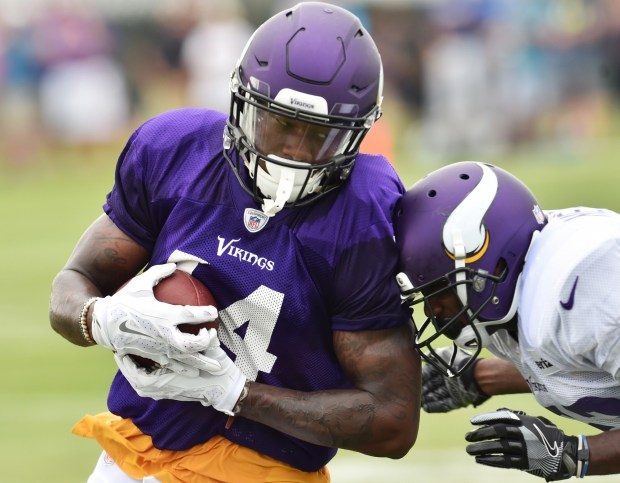 Minnesota Vikings cornerback Terence Newman, right, uses his head to stop wide receiver Stefon Diggs in the afternoon workout at the team's training camp at Minnesota State University in Mankato on Monday, August 1, 2016. (Pioneer Press: John Autey)