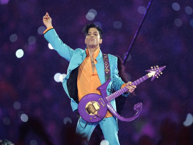 Prince performs during the halftime show at the Super Bowl XLI football game at Dolphin Stadium in Miami on Feb. 4, 2007. (AP Photo/Chris O'Meara, File)