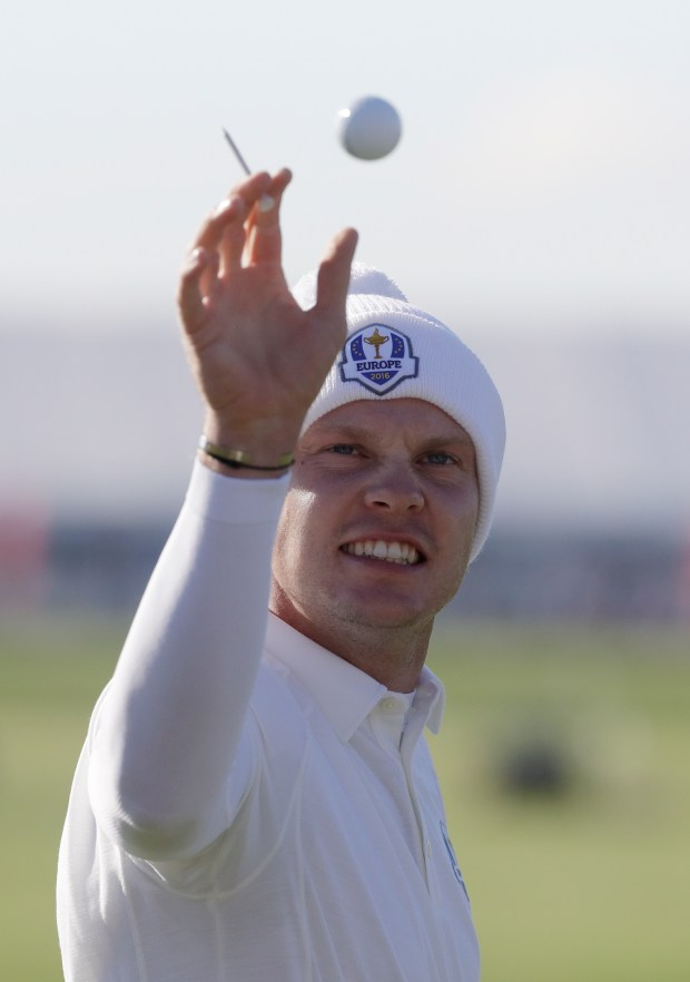 Europe's Danny Willett catches a ball on the range before a practice round for the Ryder Cup golf tournament Thursday, Sept. 29, 2016, at Hazeltine National Golf Club in Chaska, Minn. (AP Photo/Chris Carlson)