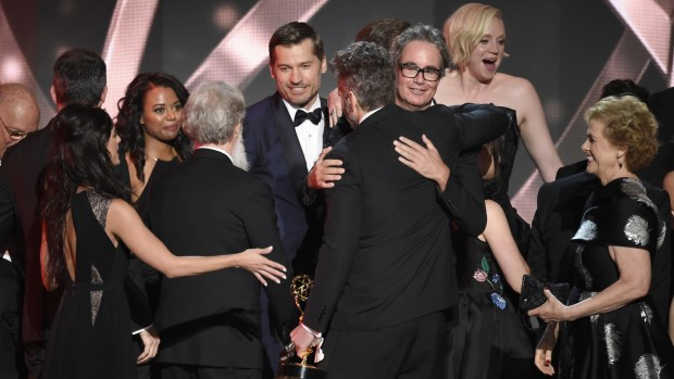 """The cast and crew from """"Game of Thrones"""" accept the award for outstanding drama series at the 68th Primetime Emmy Awards on Sunday, Sept. 18, 2016, at the Microsoft Theater in Los Angeles. (Photo by Chris Pizzello/Invision/AP)"""