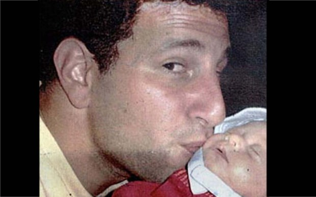 """Jeremy Glick's last words to his wife before he died aboard United Flight 93 in Shanksville, Penn., on Sept. 11, 2001: """"We're going to rush the hijackers."""" Glick, 31 at the time and shown kissing his daughter, was born on this day in 1970. (Associated Press file photo)"""