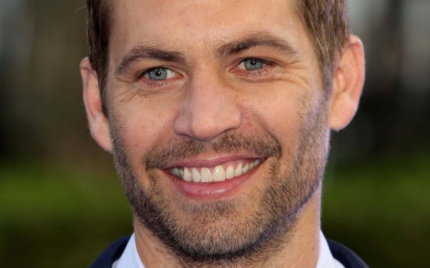 """The late actor Paul Walker of """"The Fast and the Furious"""" was born on this day in 1973. He died in a fiery car crash in 2013. (Getty Images: Tim P. Whitby)"""