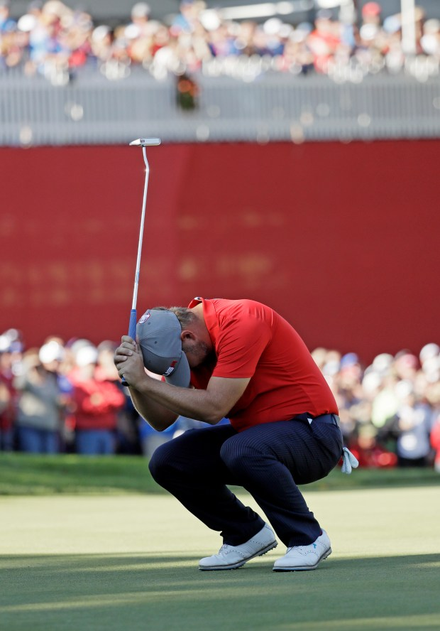 United States' Ryan Moore reacts to a missed birdie putt on the eighth hole during a four-balls match at the Ryder Cup golf tournament Friday, Sept. 30, 2016, at Hazeltine National Golf Club in Chaska, Minn. (AP Photo/David J. Phillip)