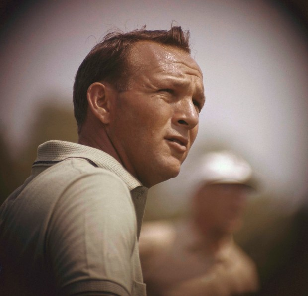 This Jan. 28, 1962, file photo shows Arnold Palmer concentrating on his next move during the Lucky International Open at San Francisco's Harding Park. (AP Photo, File)