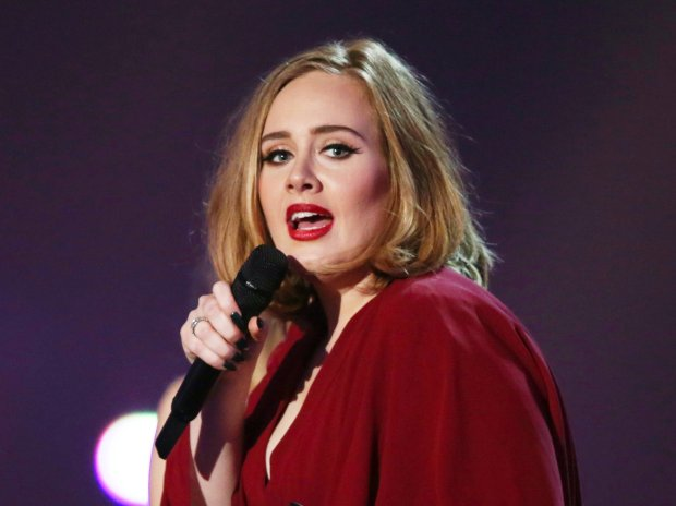 FILE - In this Feb. 24, 2016 file photo shows Adele onstage at the Brit Awards 2016 at the 02 Arena in London. NFL and Pepsi said Monday they have had several conversations with artists about performing at the Super Bowl, but said they haven't formally asked Adele or any other musicians to appear. The British singer told an audience Saturday, Aug. 13, 2016, at her Los Angeles concert that she was asked to perform at the event. (Photo by Joel Ryan/Invision/AP, File)