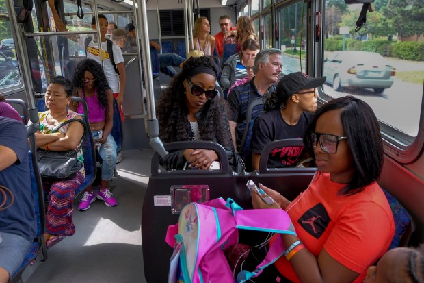 Diamond Reynolds, center, along with her sister, Ariel Doty, foreground, and other family and friends take a shuttle bus to the Minnesota State Fair on August 26. (Washington Post: Jahi Chikwendi)