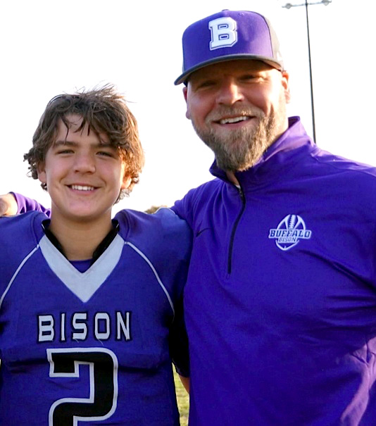 Aidan Bouman, a Buffalo High School freshman quarterback, and his dad, Todd Bouman, the Buffalo coach and a former Vikings quarterback. (Photo courtesy Courtney Bouman)