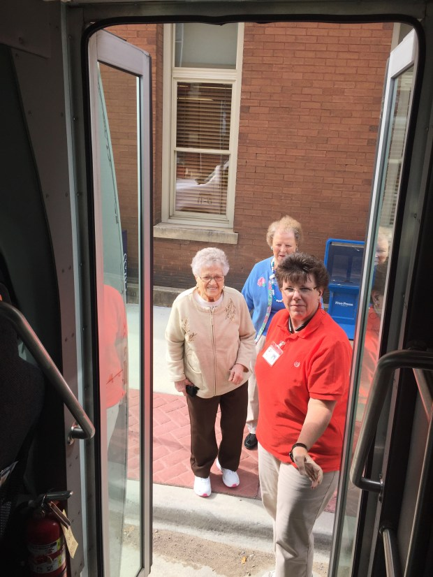 DARTS driver Teri Crews helps Helen Hansen, 88, foreground, Delores Walker, 85, onto a Loop bus in downtown Hastings on Tuesday, Sept. 27, 2016. (Pioneer Press: Nick Ferraro)