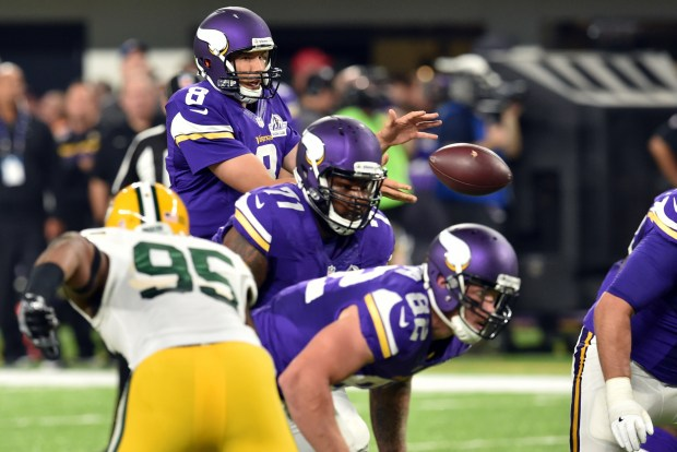 Minnesota Vikings quarterback Sam Bradford takes the snap from the shotgun formation against the Green Bay Packers in the second quarter at U.S. Bank Stadium in Minneapolis on Sunday, Sept. 18, 2016. (Pioneer Press: John Autey)