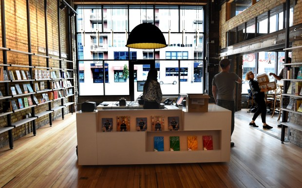 Daley Konchar-Farr, bookseller and events coordinator, right, holds just-delivered boxes of books at Milkweed Books in the Open Book building in Minneapolis Thursday, Sept. 15, 2016. Milkweed Books is the first bookstore in the Twin Cities that is being opened by a publisher - Milkweed Editions - which is in the same building. It opens to the public on Sept. 20. (Pioneer Press: Jean Pieri)