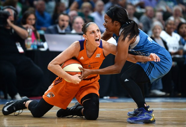 Minnesota Lynx guard Jia Perkins, right, tries to take the ball away from Phoenix Mercury guard Diana Taurasi at the Xcel Energy Center on Friday, Sept. 30, 2016. (Pioneer Press: Liam James Doyle)