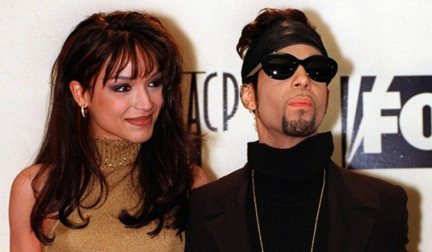 Prince poses backstage with his wife, Mayte Garcia, at the 28th annual NAACP Image Awards on Feb. 8, 1997, in Pasadena, Calif. (AP Photo/Mark J. Terrill, File)