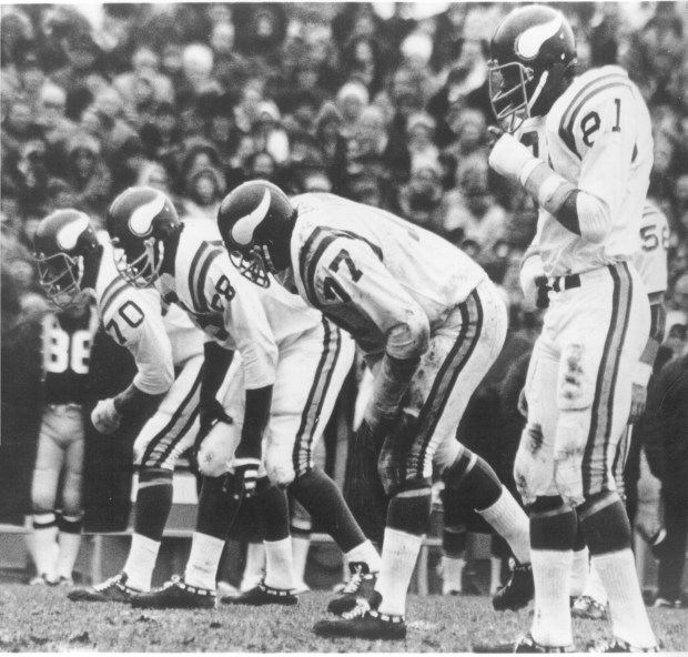 "The ""Purple People Eaters"" — Jim Marshall (70), Alan Page (88), Gary Larsen (77) and Carl Eller (81) — line up during a game in the early 1970s. The foursome formed a dominating defensive line for the Vikings in the late 1960s and early '70s. (Courtesy Minnesota Vikings)"