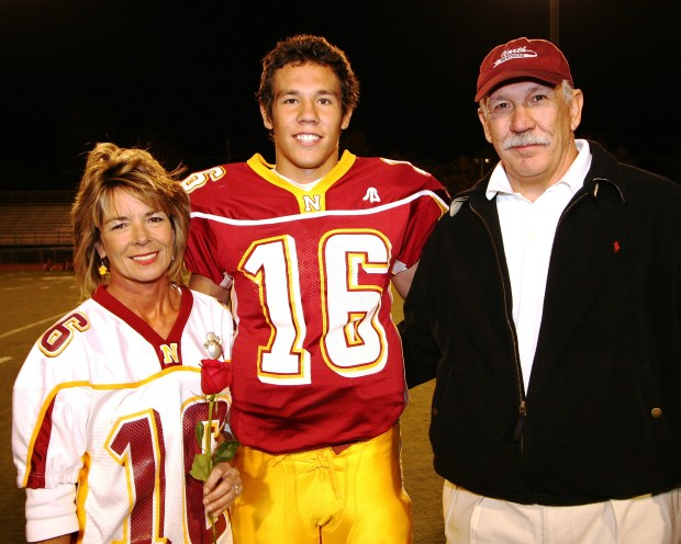 Minnesota Vikings quarterback Sam Bradford, center, is shown with parents Martha and Kent Bradford on high school senior night at Putnam City North High School in Oklahoma City, Okla. (Photo Courtesy Of Richard T. Clifton)