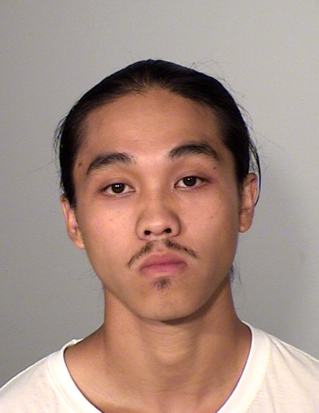 Sept. 2016 courtesy photo of Song John Vue, 21, who was charged Thursday, Sept. 8, 2016 with two counts of unlawful possession of a firearm after he allegedly pointed a gun at a police officer in St. Paul Tuesday. Vue's criminal history includes felony convictions that make him ineligible to have firearms. Photo courtesy of the Ramsey County Sheriff's Office.