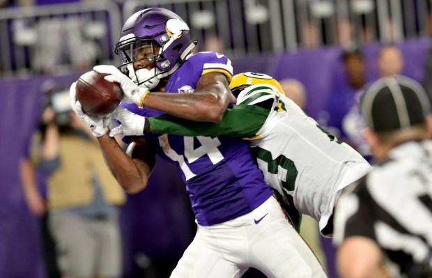 Minnesota Vikings wide receiver Stefon Diggs comes down the the quarterback Sam Bradford touchdown pass in front of Green Bay Packers cornerback Damarious Randall in the third quarter at U.S. Bank Stadium in Minneapolis on Sunday, Sept. 18, 2016. (Pioneer Press: John Autey)