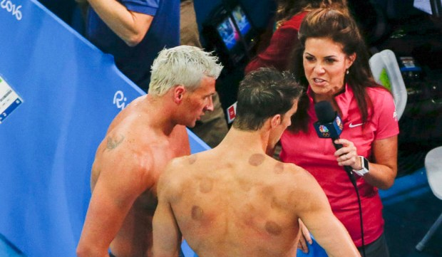 Michele Tafoya interviews Ryan Lochte, left, and Michael Phelps poolside for NBC's Rio Olympics coverage. (Photo by: Paul Drinkwater/NBC)