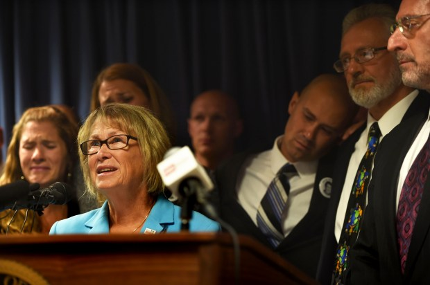 Patty Wetterling speaks as her son Trevor leans his head on his father Jerry's shoulder, during a press conference where the team of prosecutors talked about the confession of Daniel Heinrich to the killing of Jacob Wetterling, in Minneapolis, Tuesday, Sept. 6, 2016. (Pioneer Press: Scott Takushi)