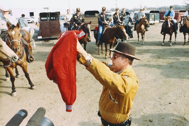 Deputy Lt. Kent Christensen displays a jacket similar to one worn by 11-year-old Jacob Wetterling when he was abducted, as law officers began a search Oct. 26, 1989, near a river by St. Joseph, Minn. (AP Photo/Jim Mone, File)
