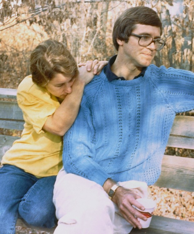 Patty Wetterling rests on her husband Jerry's shoulder on Oct. 26, 1989, five days after their 11-year-old son Jacob was abducted. (AP Photo/Jim Mone, file)