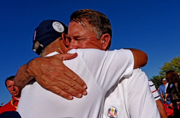 American Ryder Cup Vice Captain Tom Lehman, left, embraces Captain Davis Love III after the U.S. clinched victory on the 18th green at Hazeltine National Golf Club in Chaska, Minn., Sunday, Oct. 2, 2016. (Pioneer Press: Dave Orrick)