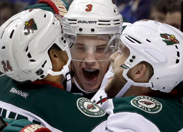 Minnesota Wild's Charlie Coyle, center, is congratulated by teammates Matt Dumba, left, and Jason Zucker after scoring during the third period of an NHL hockey game against St. Louis Blues, Thursday, Oct. 13, 2016, in St. Louis. (AP Photo/Jeff Roberson)