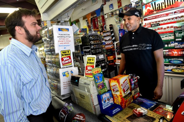 Mikeal Tekeste, right, owner of Red Sea Market on Wabasha Street in St. Paul, talks Friday, Oct. 14, 2016, with long-time customer and EcoLab employee Dan Sorenson. Tekeste saved the life of a woman who was trying to jump off the Wabasha Street Bridge in August. (Pioneer Press: Jean Pieri)