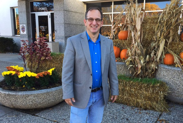 "In this Oct. 18, 2016 photo, Crystal, Minn., Mayor Jim Adams poses in front of city hall in Crystal. Since the 2014 election, the officially nonpartisan council in Crystal has included multiple Libertarian Party members and multiple ""liberty-minded"" allies, including Adams. In keeping with the party's frugal philosophy, the city spent $13 million in cash on the new public works building instead of borrowing the money. (AP Photo/Steve Karnowski)"