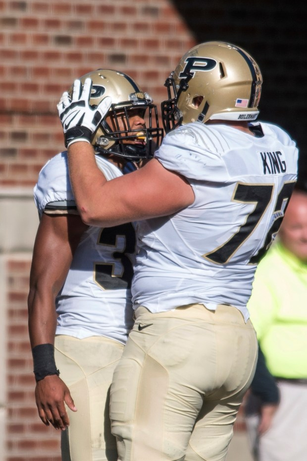 Purdue guard Jason King (72) congratulates Purdue running back Brian Lankford-Johnson (37) after his touchdown run during the first half of an NCAA college football game against Illinois Saturday, Oct. 8, 2016, in Champaign, Ill. (AP Photo/Bradley Leeb)