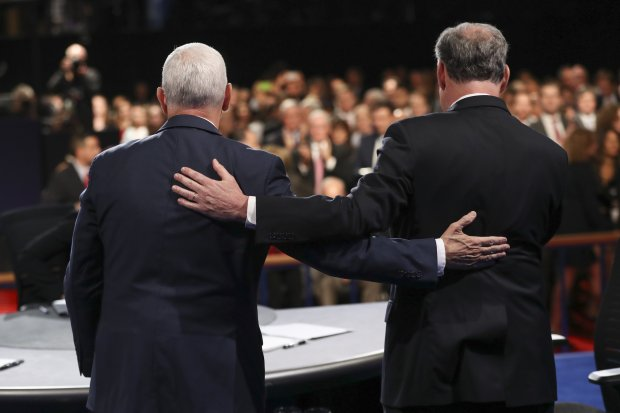 Republican vice-presidential nominee Gov. Mike Pence and Democratic vice-presidential nominee Sen. Tim Kaine stand after the vice-presidential debate at Longwood University in Farmville, Va., Tuesday, Oct. 4, 2016. (Joe Raedle/Pool via AP)