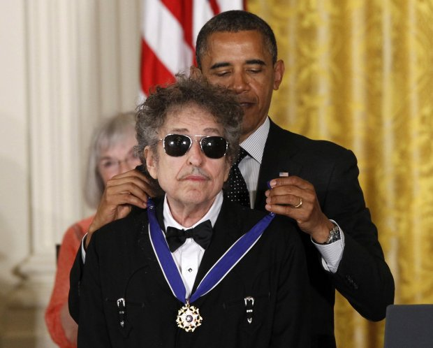 In this May 29, 2012, file photo, President Barack Obama presents rock legend Bob Dylan with a Medal of Freedom during a ceremony at the White House in Washington. Dylan won the 2016 Nobel Prize in literature, announced Thursday, Oct. 13, 2016. (AP Photo/Charles Dharapak, File)