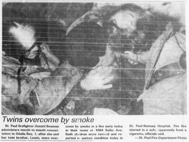 This image scanned from Pioneer Press archives shows the photo of firefighter Donald Bowman administering mouth-to-mouth resuscitation to 1-year-old Odelia Ray in the Dec. 11, 1978, edition of the St. Paul Dispatch. Ray, whose name was changed to Leslie Garrett after she was placed into a foster home and later adopted, and her twin brother Lewis met members of the late firefighter's family for the first time on Thursday, Oct. 13, 2016, in St. Paul. (Pioneer Press archives)