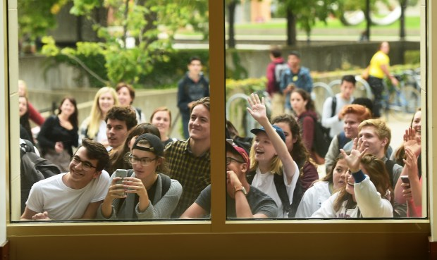 University of Minnesota students peer in, wave and take photos, as Bernie Sanders is interviewed in a Northrup Auditorium side room in Minneapolis, after the Senator spoke to a large crowd in the main auditorium, Oct. 4, 2016. (Pioneer Press: Scott Takushi)