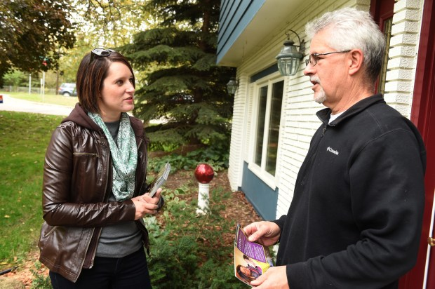 DFL Candidate for the Minnesota House Lindsey Port doorknocks in a Burnsville neighborhood and talks with homeowner Kevin Nelson, Wednesday, Oct. 12, 2016. (Pioneer Press: Scott Takushi)