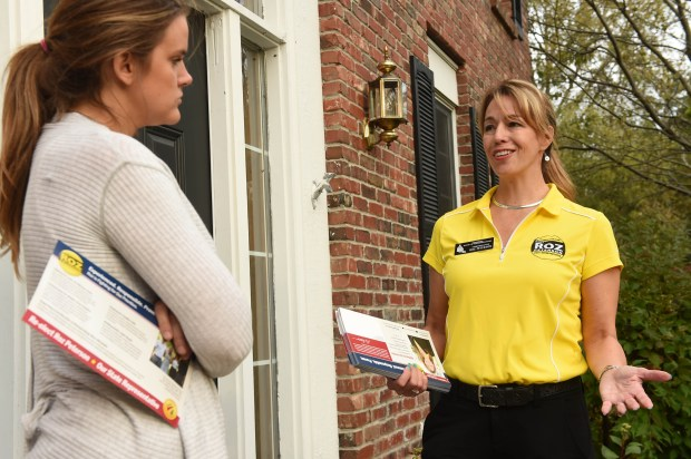 Republican candidate for the Minnesota House of Representatives Roz Peterson of Lakeville goes door to door in a Burnsville neighborhood to talk to voters like Erin Jones, Monday, Oct. 10, 2016. (Pioneer Press: Scott Takushi)