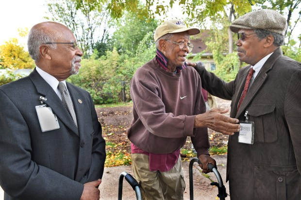 """It's a long time in coming. I have lots of old memories. I was born and raised here and I used to live four blocks away,"" said Bob Blakeley, 80, center, as he greets his friends, Marvin Roger Anderson, left, Rondo Avenue Inc. co-founder and Plaza Project Manager, and Floyd J. Smaller Jr., Rondo Avenue Inc. co-founder at the groundbreaking ceremony of the Rondo Commemorative Plaza in St. Paul on Friday, Oct. 14, 2016. (Pioneer Press: Jean Pieri)"