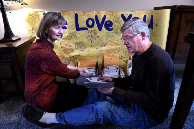 Mary and Bill Fowler go through boxes of old condolence notes on Thursday, Oct. 27, 2016. After their son, Aaron, died from leukemia in 2005 they started a charity and granted projects. Now, after 11 years, they are winding down the charity and want to thank people for their support.(Pioneer Press: Jean Pieri)