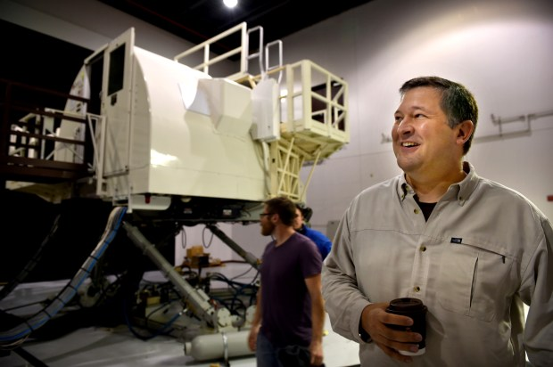 """I learned to fly DC-9s at this facility using these simulators,"" said Delta pilot Shawn Hokuf of Mendota Heights at a public preview of items being auctioned in the former Northwest Airlines/Delta flight training center in Eagan Friday, Oct. 7, 2016. (Pioneer Press: Jean Pieri)"
