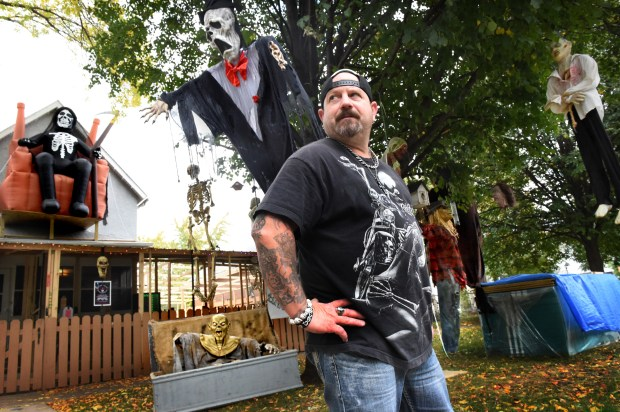 """For now they (St. Paul Department of Safety) can't stop me from hanging Halloween decorations,"" said Ed Johnson in St. Paul on Friday, Oct. 7 2016. Ed Johnson has run a haunted house in his backyard since 1999 and five years ago he added many attractions and themed rooms in a temporary structure. The St. Paul Department of Safety and Inspections recently ordered him to cease and desist and get an event permit because they worried about the steel-paneled roof on the 10-room outdoor facility. (Pioneer Press: Jean Pieri)"