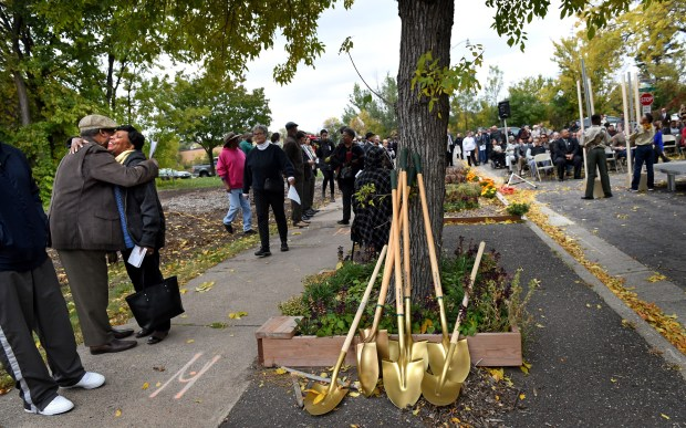 People hug at the groundbreaking ceremony of the Rondo Commemorative Plaza in St. Paul on Friday, Oct. 14, 2016. (Pioneer Press: Jean Pieri)