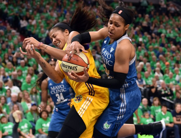 Minnesota Lynx forward Maya Moore collides with Los Angeles Sparks forward Candace Parker as they rebound the ball in the third quarter in game 5 of the WNBA Championship game at Target Center on Thursday, October 20, 2016. The Los Angeles Sparks beat the Minnesota Lynx, 77-76, to claim the 2016 WNBA Championship Trophy. (Pioneer Press: John Autey)