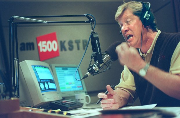 Conservative talk show host Jason Lewis argues a point with a listener during a recent discussion of a 2000 presidential debate during his nightly talk show host at KSTP-AM in this Oct. 5, 2000 file photo.
