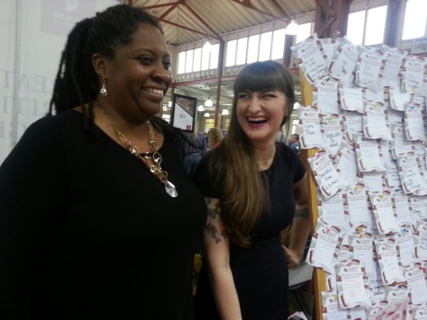 Sherrie Fernandez-Williams, program manager at the Loft Literary Center and Katriona Molasky, administrative assistant, staffed the Loft table where people were asked to write on a card the piece of writing that changed their lives during the Twin Cities Book Festival Saturday, Oct. 15, 2016, at the Minnesota State Fairgrounds. (Pioneer Press: Mary Ann Grossmann)