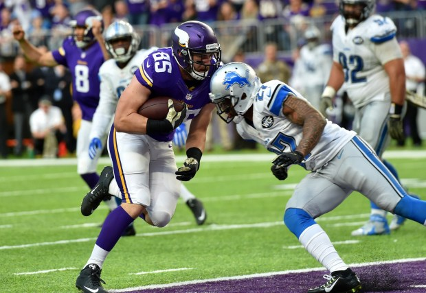 Minnesota Vikings tight end Rhett Ellison scores on a one yard run just as Detroit Lions free safety Glover Quin lays into him in the fourth quarter at U.S. Bank Stadium on Sunday, Nov. 6, 2016. The Lions beat the Vikings in overtime, 22-16. (Pioneer Press: John Autey)