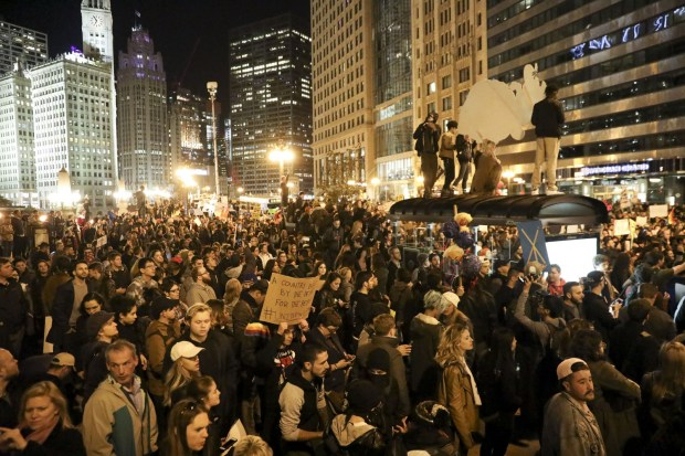 Protesters rally near the intersection of North Wabash Avenue and East Upper Wacker Drive in downtown Chicago on Wednesday, Nov. 9, 2016. (Armando L. Sanchez/Chicago Tribune/TNS)
