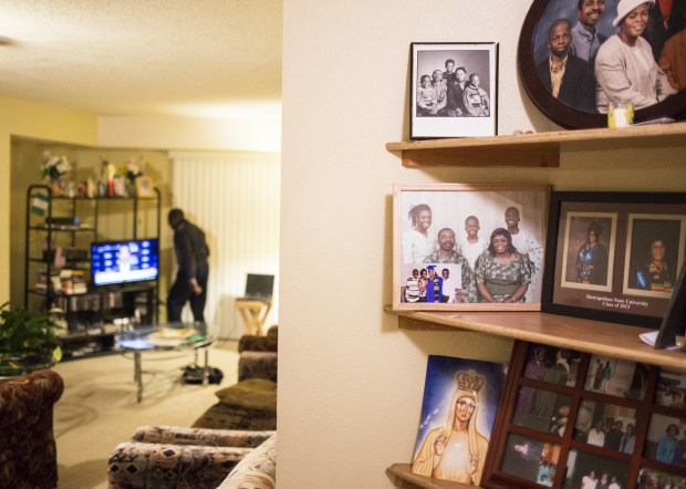 Family photos adorn corner shelves of Cyprian Onyeaghala's home in White Bear Lake. Onyeaghala remembers his son Ben as an intelligent, hard-working and compassionate young man with a strong and positive presence. (Pioneer Press: Liam James Doyle)