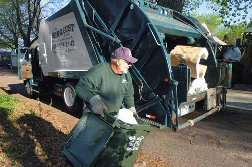 Garbage hauler Jim Berquist, photographed at work Sept. 11, 2014, services almost every house along the alley behind Princeton Avenue between Prior and Kenneth, thanks to help from customer Todd Seabury-Kolod, who persuaded his neighbors to contract with Berquist to reduce the number of garbage trucks lumbering down their alley.
