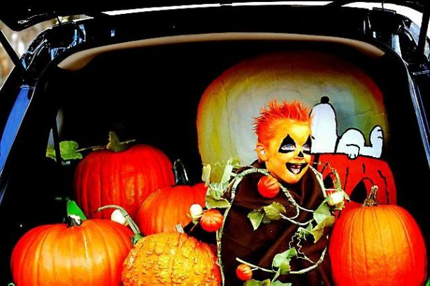 "Five-year-old Tyler Lemke gives the kids a smile in the pumpkin patch that his mother, Ginger Lemke, made in the family minivan during ""trunk or treat"" at Good Shepherd Church in October 2014. (Pioneer Press: Sherri LaRose-Chiglo)"