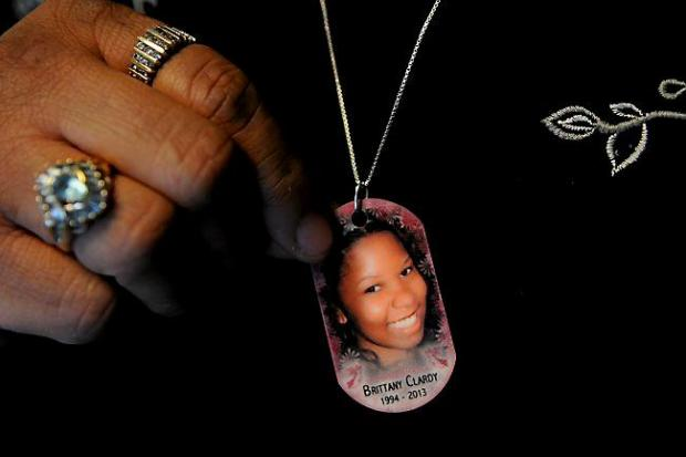Marquita Clardy wears a necklace with her daughter Brittany's photo at Brittany's Place in St. Paul Wednesday, Nov. 26, 2014. Marquita's daughter Brittany was brutally murdered 22 months ago and now the shelter for victims of sex trafficking is open under her name. (Pioneer Press: Jean Pieri)