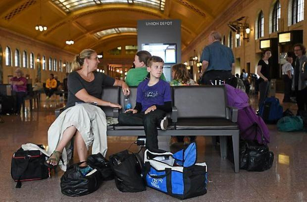 Amanda Hirsh and Isaiah Palmer, 9, of St. Paul wait for the Amtrak Empire Builder train at Union Depot in St. Paul on Thursday, July 16, 2015. The two were taking their first family trip to Chicago. (Pioneer Press: Holly Peterson)
